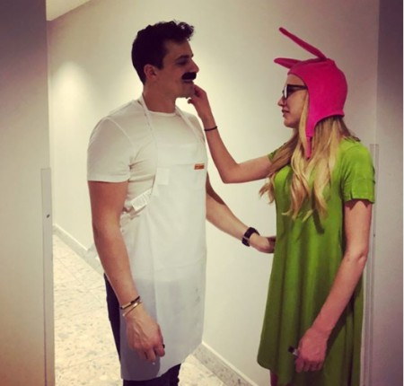 Kat wearing a green dress with a pink beanie and Cameron wearing white T-shirt.