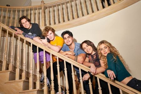 Alex poses with his hype house members on the staircase of The Hype House mansion