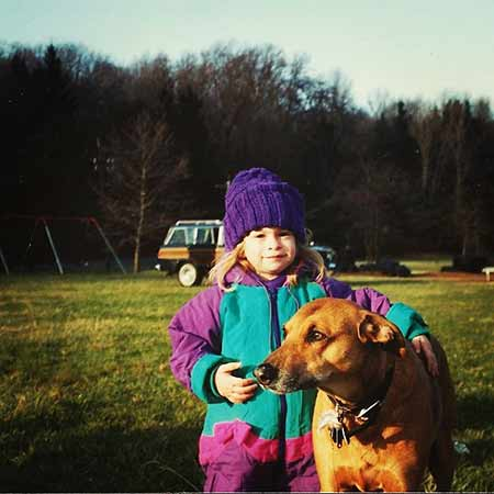Al Pacino's daughter Julie Marie Pacino's childhood photo with her pet dog in a ground