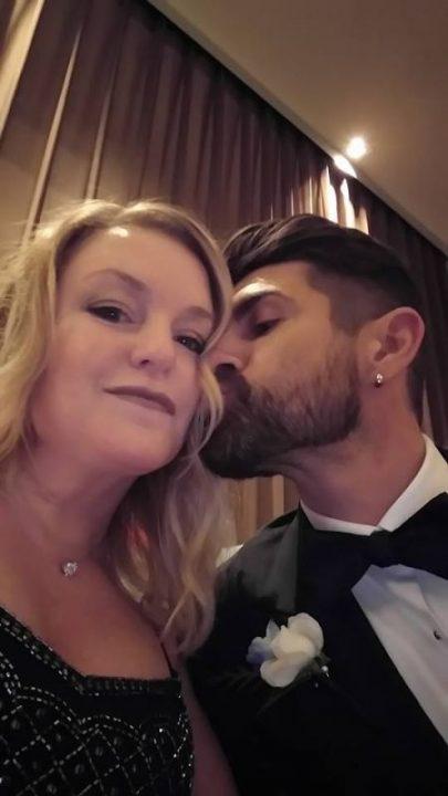 Aaron Marino kissing wife Tracey Marino.