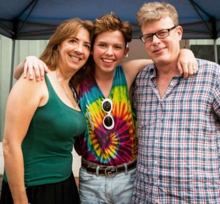 Jacob with his mom and dad.