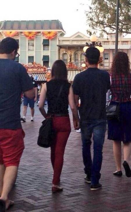 Lily Collins and Zac Effron Holding Hands in Disneyland.