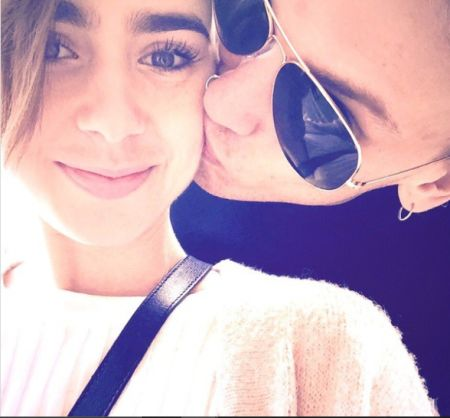Lily Collins kissed by Jamie Campbell