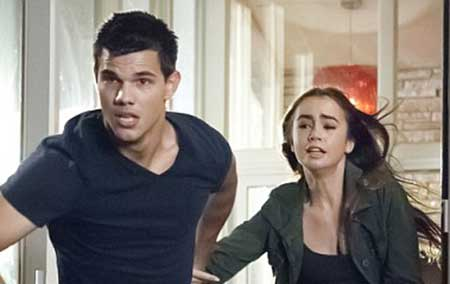 Actor Taylor Lautner and Lily Collins during a movie scene