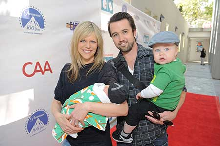 Actress Kaitlin Olson and her husband with their two children