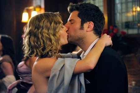 James Roday wife Maggie Lawson kissing on the set of Psych.