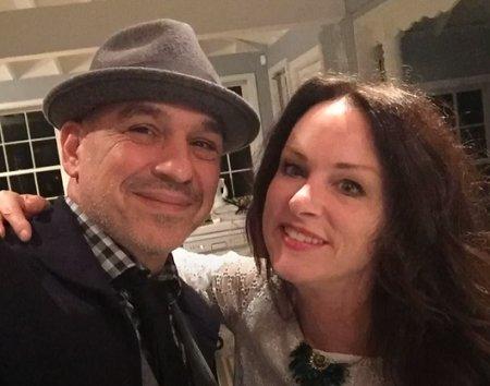 Michael Symon married Liz.