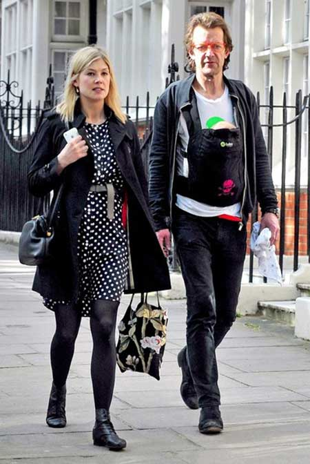 Robie and his partner Rosamund Pike