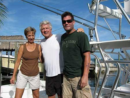 Rhonda with Jimmy Johnson and his son, Chad Johnson