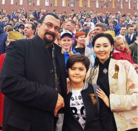 Erdenetuya Seagal with her son Kunzang Seagal and husband