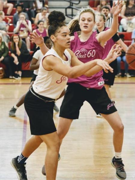 Senali Moss plays basketball