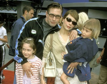 Kennya Baldwin and her husband with their daughters.