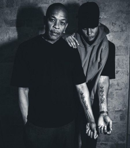 Dr. Dre and his son Truice's matching tattoo.