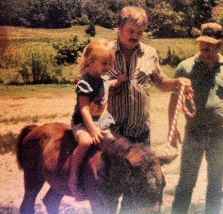 Kristen Tuff Scott riding a horse as a child.