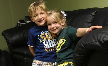 Billy Beane's twins with his life partner Tara Beane
