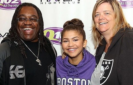 Zendaya with her parents.
