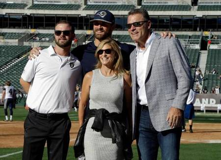 Diane Addonizio with her sons, Howard Jr (left), Chris Long (middle), and husband, Howie Long