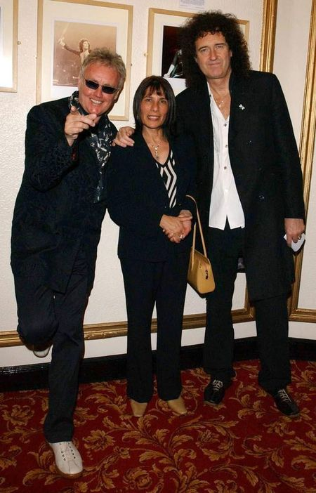 Kashmira with Freddie's former Queen bandmates Roger Taylor and Brian May (Image: PA Archive/PA Images)