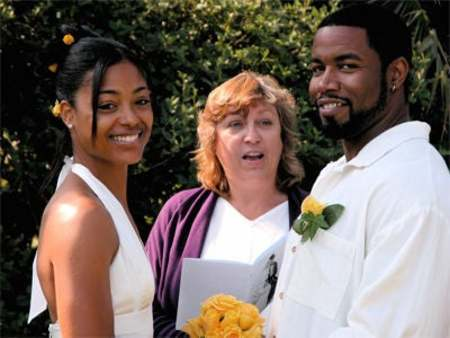 Courtenay Chatman and Michael J White during their wedding