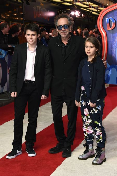 Billy Raymond Burton with his father, Tim Burton, and sister, Nell Burton at the premiere of Dumbo