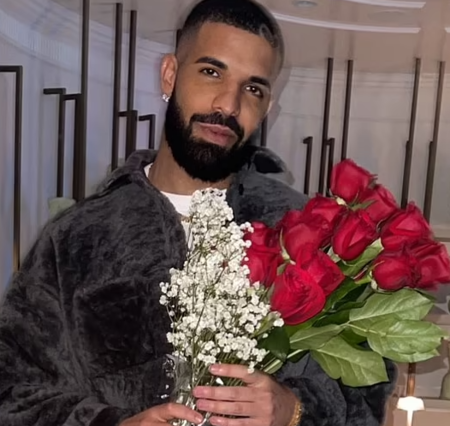Drake showing the flowers his mother sent him